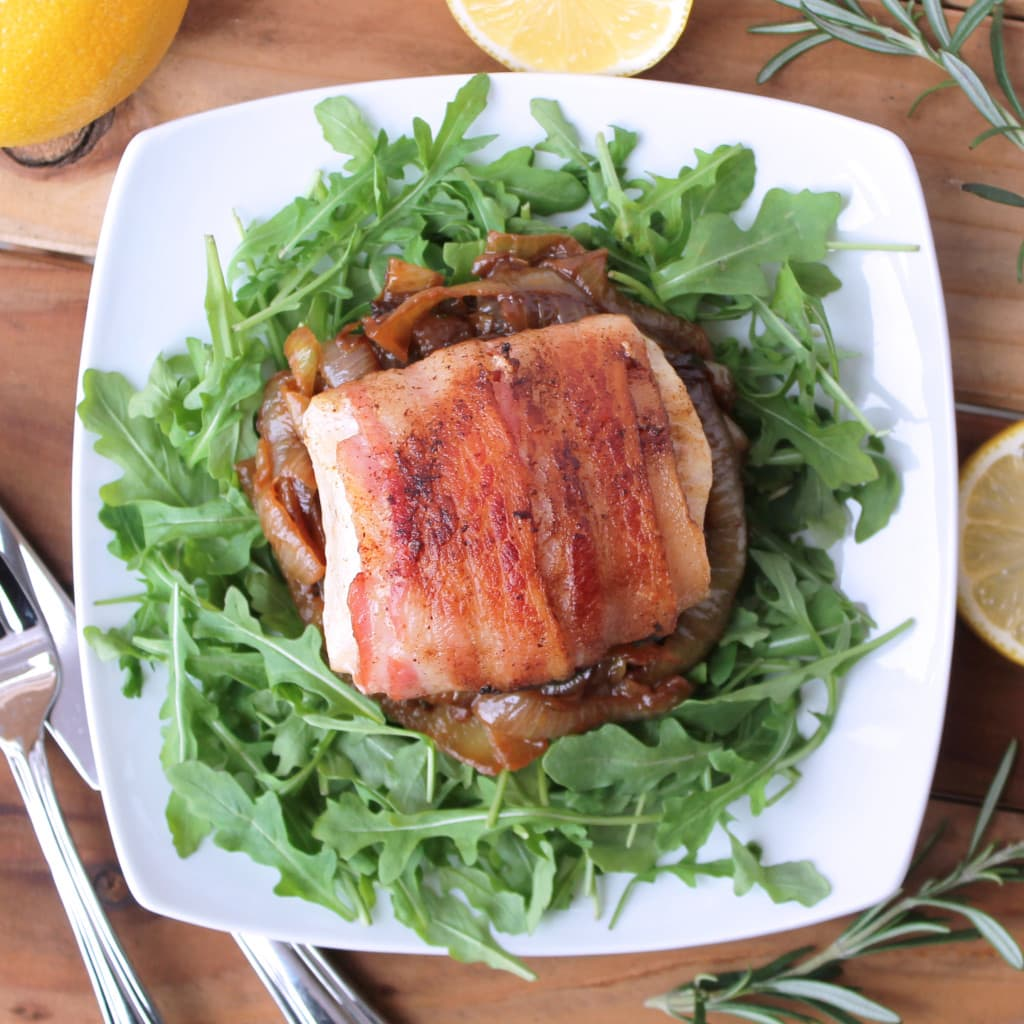 Bacon-wrapped Cobia Fillets with Rosemary Caramelized Onions and Arugula