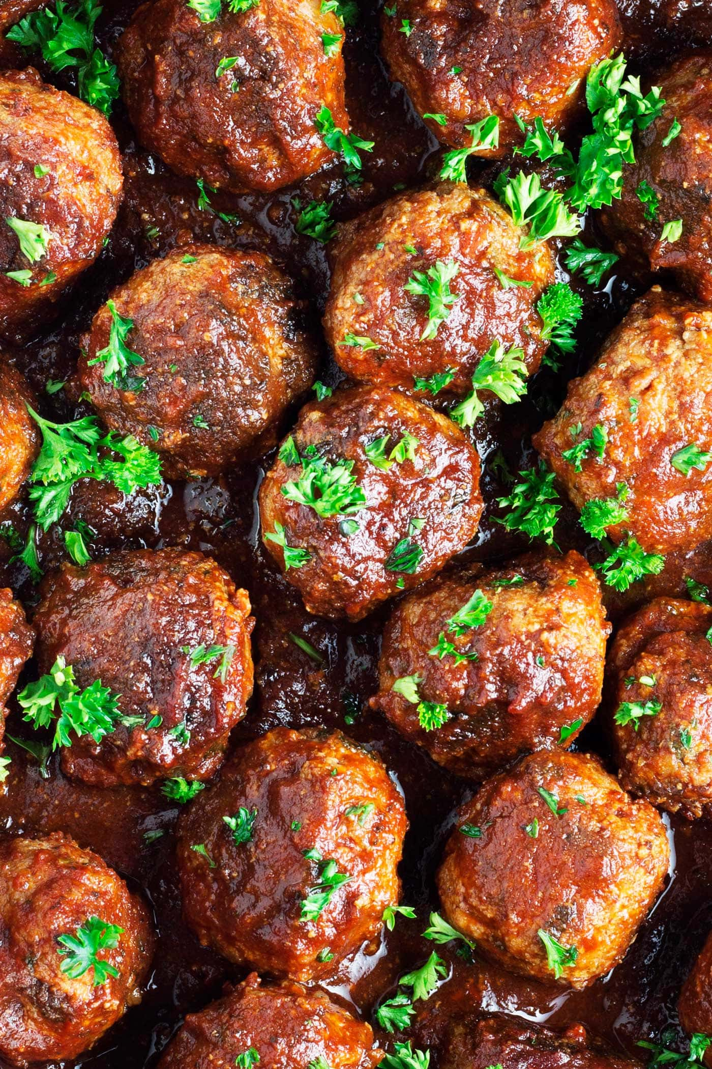 Perfect as a game day appetizer or for dinner! These bacon bourbon meatballs are easy to make and full of flavor. They are paleo, gluten free, dairy free, low carb, and can be made keto!